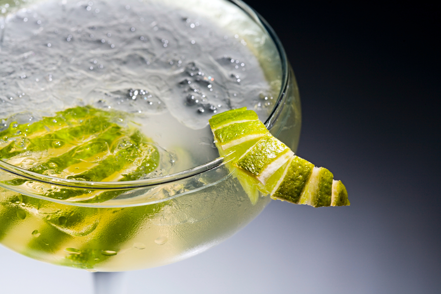 Close-up of alcoholic drinks with pieces of lime